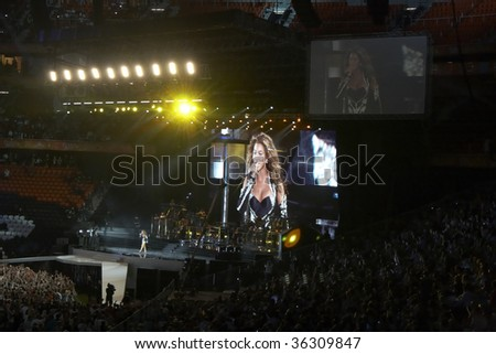 DONETSK, UKRAINE - AUGUST 29: Singer Beyonce Knowles performs on onstage in the opening of Shakhtar Donetsk's new soccer stadium August 29, 2009 in Donetsk, Ukraine. - stock photo