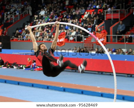 DONETSK,UKRAINE-FEB.11: BRAD WALKER - World Champion compete in the pole vault competition with the result 5.62 on Samsung Pole Vault Stars meeting on February 11, 2012 in Donetsk, Ukraine. - stock photo
