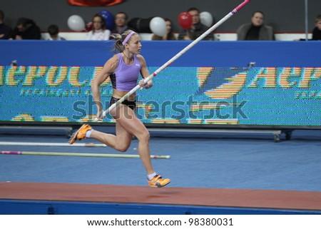 DONETSK, UKRAINE - FEB.11: Ptacnikova Jirina - czech pole vaulter, wins first place with National Record 4.70 on Samsung Pole Vault Stars meeting on February 11, 2012 in Donetsk, Ukraine. - stock photo