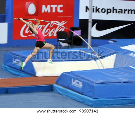 DONETSK,UKRAINE-FEB.11: Shelekh Hanna, bronze medalist of 1st Youth Olympic Games wins third place with Nation Rekord 4.60 on Samsung Pole Vault Stars meeting on February 11, 2012 in Donetsk, Ukraine. - stock photo