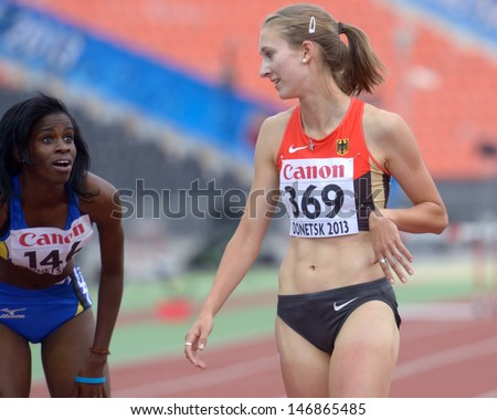 DONETSK, UKRAINE - JULY 13: Belle of Barbados (left) and Jacoby of Germany after finish in the final of 400 m hurdles during 8th IAAF World Youth Championships in Donetsk, Ukraine on July 13, 2013