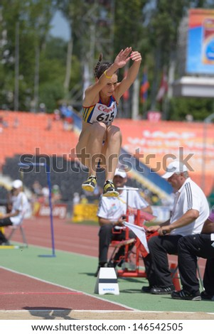 DONETSK, UKRAINE - JULY 13: Florentina Marincu, Romania, fight for her gold medal in long jump during World Youth Championships in Donetsk, Ukraine on July 13, 2013