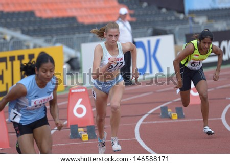 DONETSK, UKRAINE - JULY 12: Sirc, Slovenia (center), Chand, India (left), and Pereira, Singapore compete in 200 meters during 8th IAAF World Youth Championships in Donetsk, Ukraine on July 12, 2013