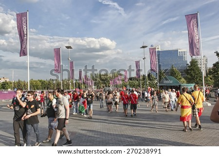 DONETSK, UKRAINE - JUNE 27, 2012: Fans gather for soccer semifinal match of Euro 2012 Spain vs. Portugal in Donetsk Donbass Arena. Spain won by penalties and then won final match - stock photo