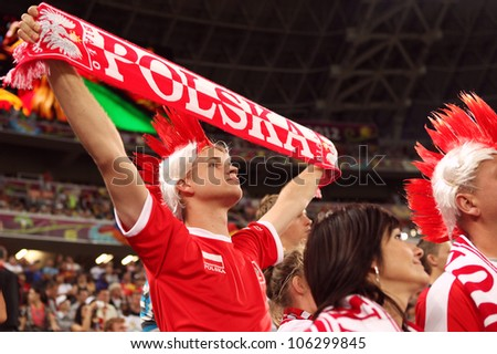 DONETSK, UKRAINE - 27 JUNE 2012: Football fans from Poland on the semifinal match Spain - Portugal. Donetsk, Donbass Arena. EURO 2012 in Ukraine, 27 june 2012 - stock photo