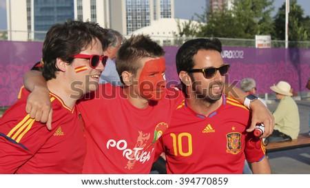 DONETSK, UKRAINE - JUNE 27, 2012: Unidentified Spanish soccer fans with Portugal fanl before UEFA EURO 2012 match in Donetsk near Donbass Arena - stock photo