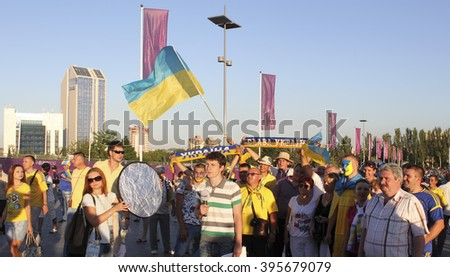 DONETSK, UKRAINE - JUNE 19, 2012: Unidentified Ukrainian anchorman with soccer fans before UEFA EURO 2012 match in Donetsk on Donbass Arena - stock photo