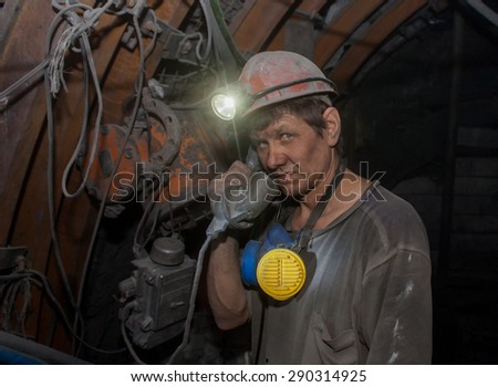 Donetsk, Ukraine - March, 14, 2014: Miner with a phone in the mine named after Abakumov - stock photo