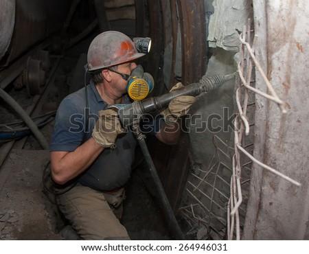 Donetsk, Ukraine - March, 14, 2014: Miner working underground in the mine named after Abakumov - stock photo