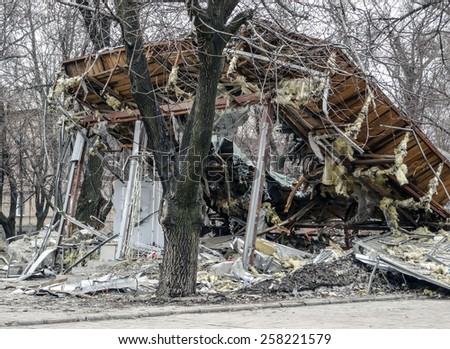 DONETSK, UKRAINE - March 4, 2015: Ruined sales pavilion, Kiev Avenue -- This area is adjacent to the Donetsk airport named after Sergei Prokofiev.  - stock photo