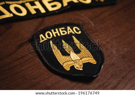"DONETSK, UKRAINE - MAY 23:Captured badges of the punitive battalion ""Donbass"" in the Donetsk Regional State Administration on may 23, 2014 in Donetsk."