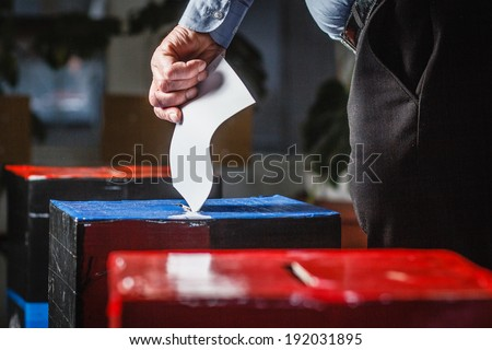 DONETSK, UKRAINE - MAY 11: People voting at one of the polling stations for independence referendum, on may 11, 2014 in Donetsk. - stock photo