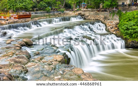 Dong Nai, Vietnam - June 19th, 2016: Falls in park destinations summer morning with water flowing down smooth as silk sheet stone steps natural scenery beautiful attract tourists to relax on weekend
