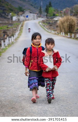 DONG VAN, HA GIANG, VIETNAM, March 11th, 2016:  H'mong ethnic two children pupils on their way to school
