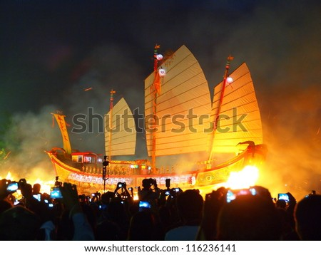 DONGGANG, TAIWAN- OCTOBER 21: The Burning King Boat Ceremony in DongGang, Taiwan on October 21, 2012. It is one of the oldest religious ceremonies in Taiwan and held every three years. - stock photo