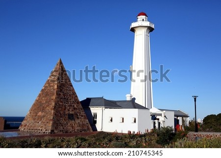 Donkin Lighthouse and Pyramid in Port Elizabeth with blue sky and moon - stock photo