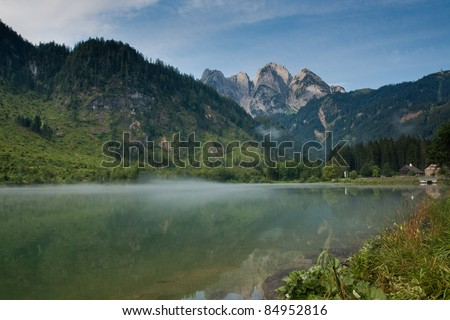 Donnerkogel Gosaukamm Mountains in Austria with reflection in Gosaub lake