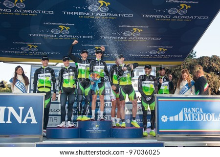 DONORATICO, LIVORNO, ITALY - MARCH 07: Team GreenEDGE on the podium after winning the 1st Team Time Trial stage of 2012 Tirreno-Adriatico on March 07, 2012 in Donoratico, Livorno, Italy