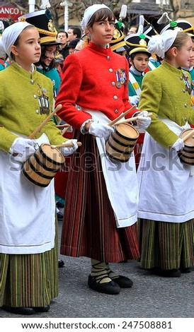DONOSTIA, SPAIN - JANUARY 20: Local girl in traditional dress participates in the parade of her city.s holiday on January 20, 2015 in San Sebastian-Spain.