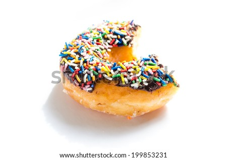 Donut bite shallow depth - stock photo