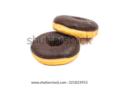 donut in chocolate glaze on a white background - stock photo