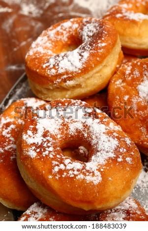 Donut is ready. Making Doughnuts - stock photo