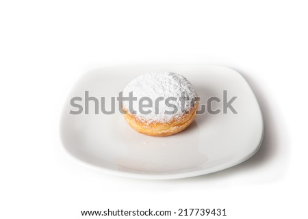 Donut on a white plate - stock photo