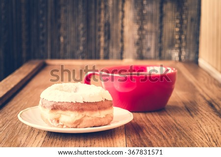 Donut. Sweet food and cup of coffee drink. Breakfast, dessert with cake, snack. Brown wooden table. Bakery, sugar doughnut. Tasty espresso black hot morning beverage.  - stock photo