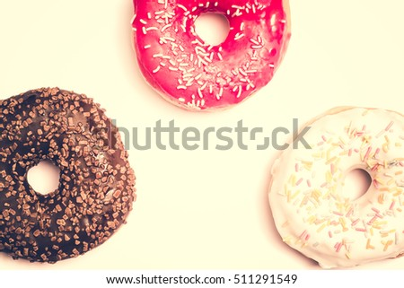 Donut. Sweet icing sugar food. Dessert colorful snack. Glazed sprinkles. Treat from delicious pastry breakfast. Bakery cake. Doughnut with frosting. Baked unhealthy round.