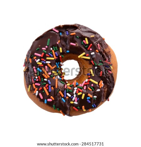Donut with Chocolate Icing and Rainbow Sprinkles Above Isolated - stock photo