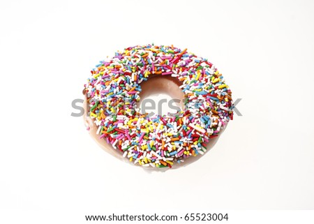 Donut with colorful sugar sprinkles. - stock photo