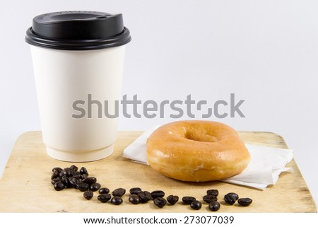 Donut with sugar and cup of hot coffee on wooden - stock photo