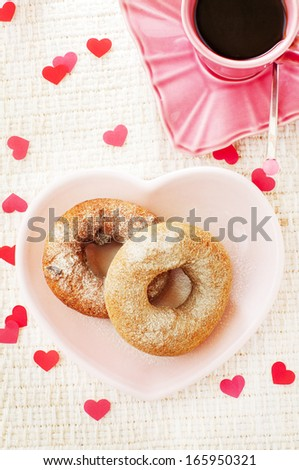 donuts and coffee and many paper hearts