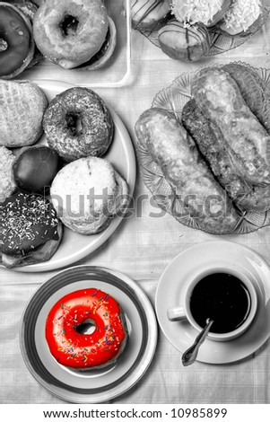 Donuts and coffee - breakfast - stock photo