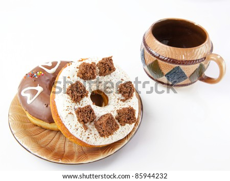 donuts and coffee on white background