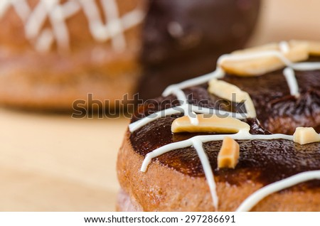 Donuts chocolate glazing on wooden background, Assorted Colorful. - stock photo