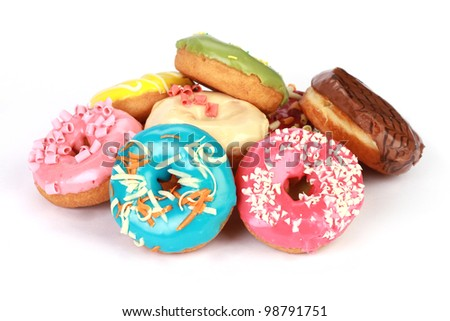 Donuts in stack on white background - stock photo