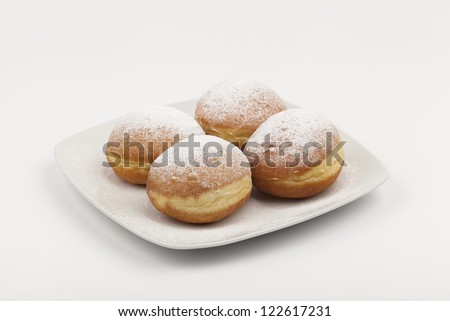donuts on a white plate - stock photo