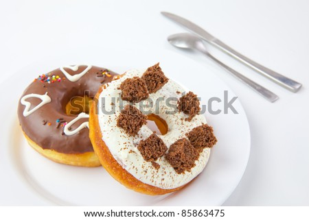 donuts on the white plate isolated on a white background - stock photo