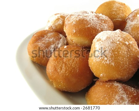 Donuts on white plate - stock photo