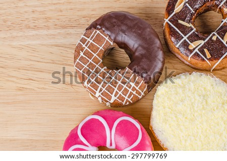 Donuts on wooden background, Assorted Colorful. - stock photo