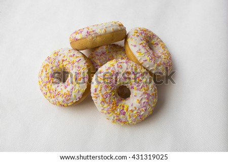 Donuts stacked slide. Crumpet for tea. Tasty food cakes. Delicious classic cakes: fried doughnuts glazed with caramel. Nutritious dish that promotes obesity. - stock photo