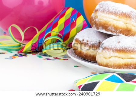 Donuts, streamers, confetti and party hat/party/carnival - stock photo