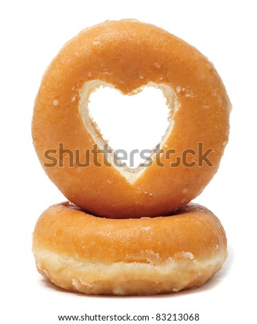donuts with a heart shaped hole on a white background - stock photo