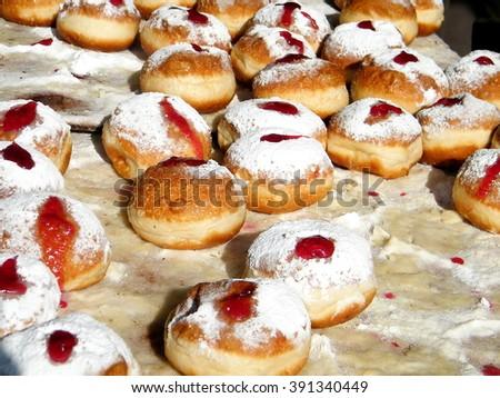 Donuts with jam on bazaar in Tel Aviv, Israel - stock photo