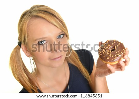 Donuts. Woman eating donut. - stock photo