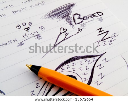 Doodle Sketch Lined Work Business Notepad With Bored Drawings and orange black bic Biro Pen Marker on White Background - stock photo