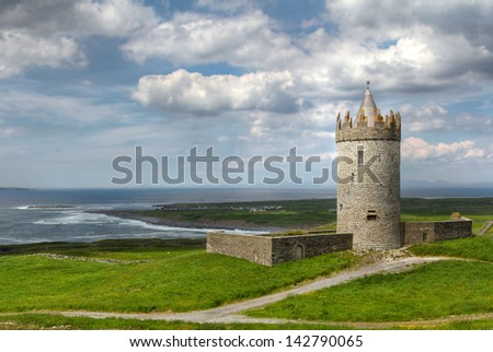 Doonagore castle on the coastal road to famous Moher cliffs. Clare county , Ireland