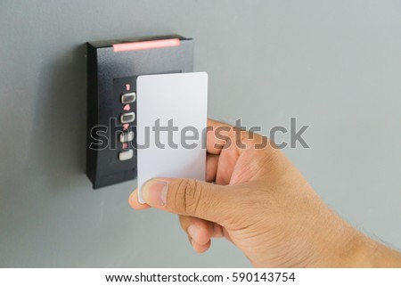 Door Access Control With A Hand Inserting Key Card To Lock And Unlock Door.  Security