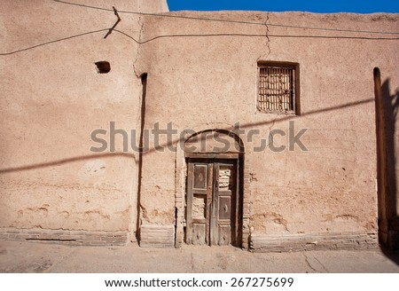 Door and closed window of an old clay house in the Middle East - stock photo